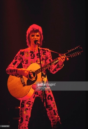 http://www.gettyimages.co.uk/detail/news-photo/photo-of-david-bowie-performing-live-onstage-on-first-date-news-photo/85062763